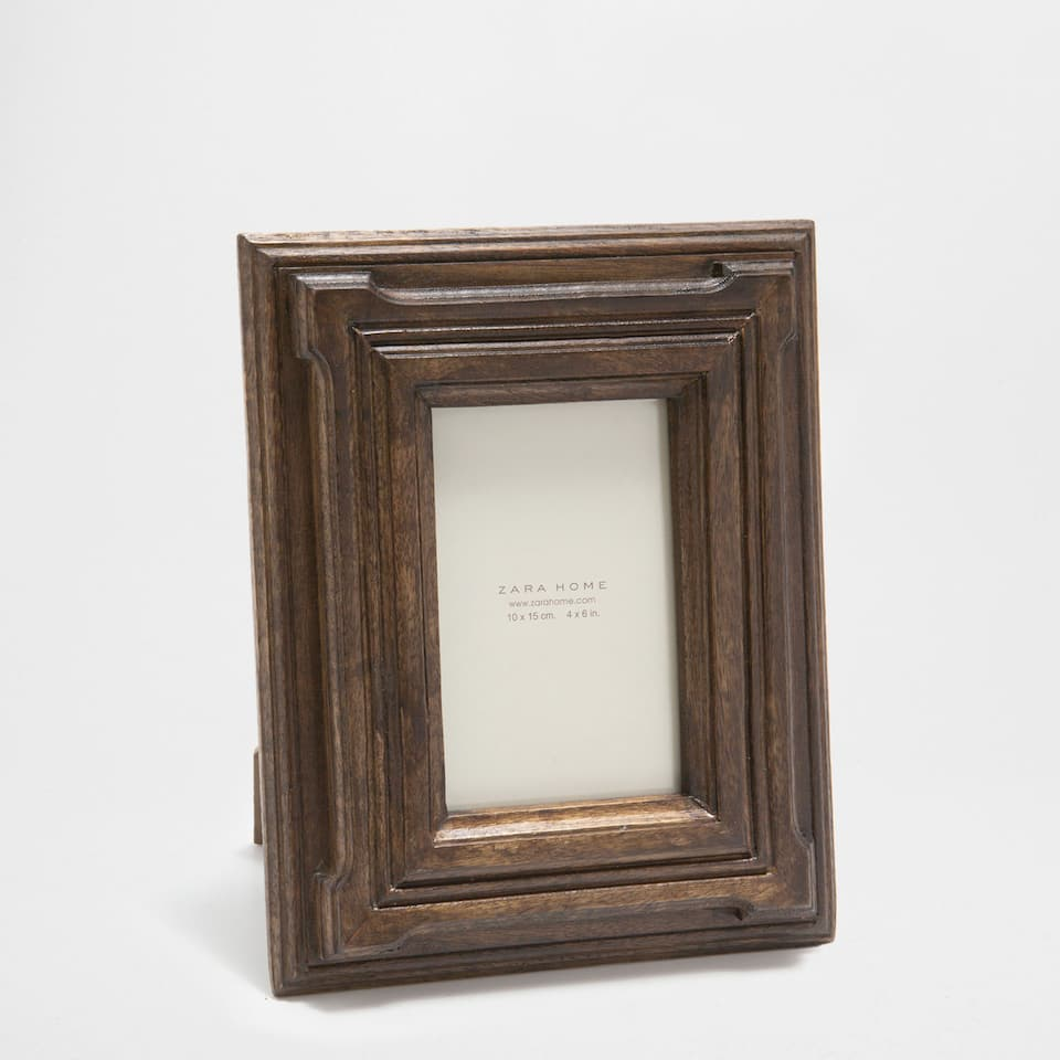DARK BROWN WOODEN FRAME WITH A RAISED DESIGN
