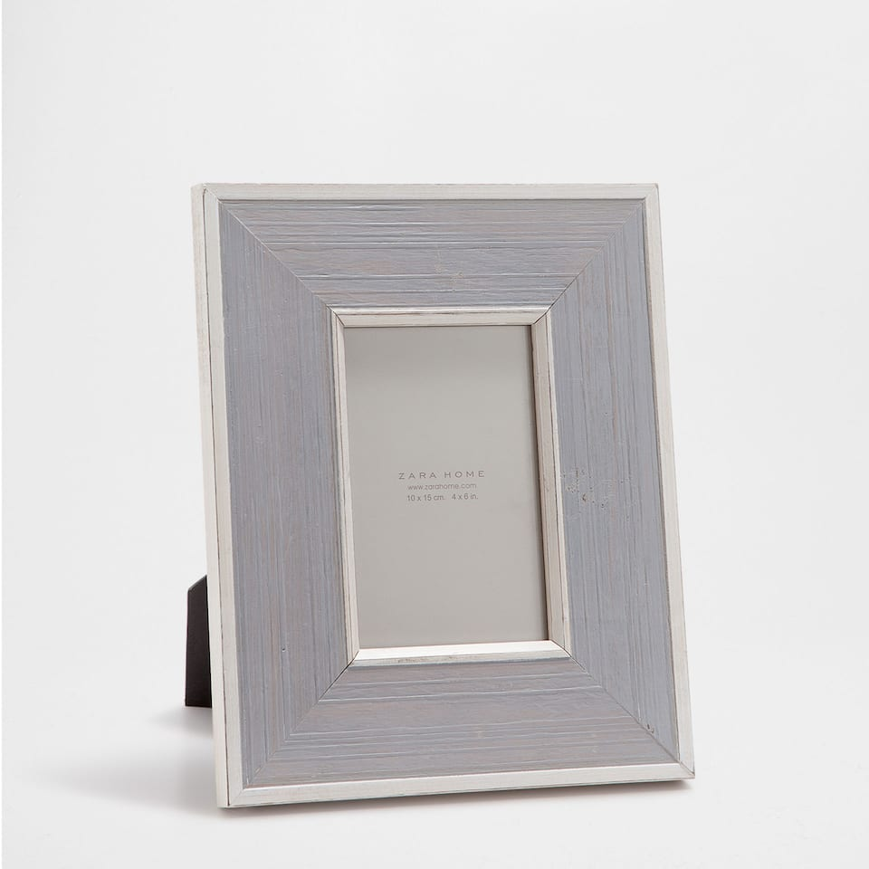 SILVER-EDGED GREY FRAME