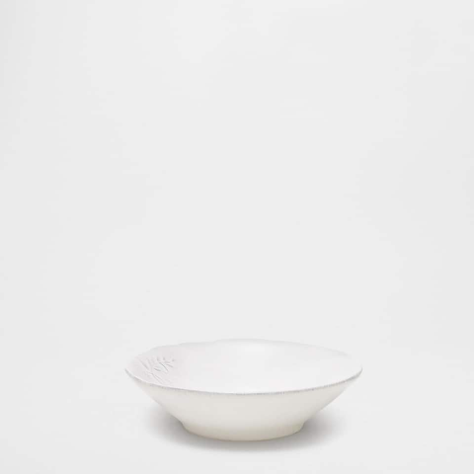 Earthenware bowl with a raised edge