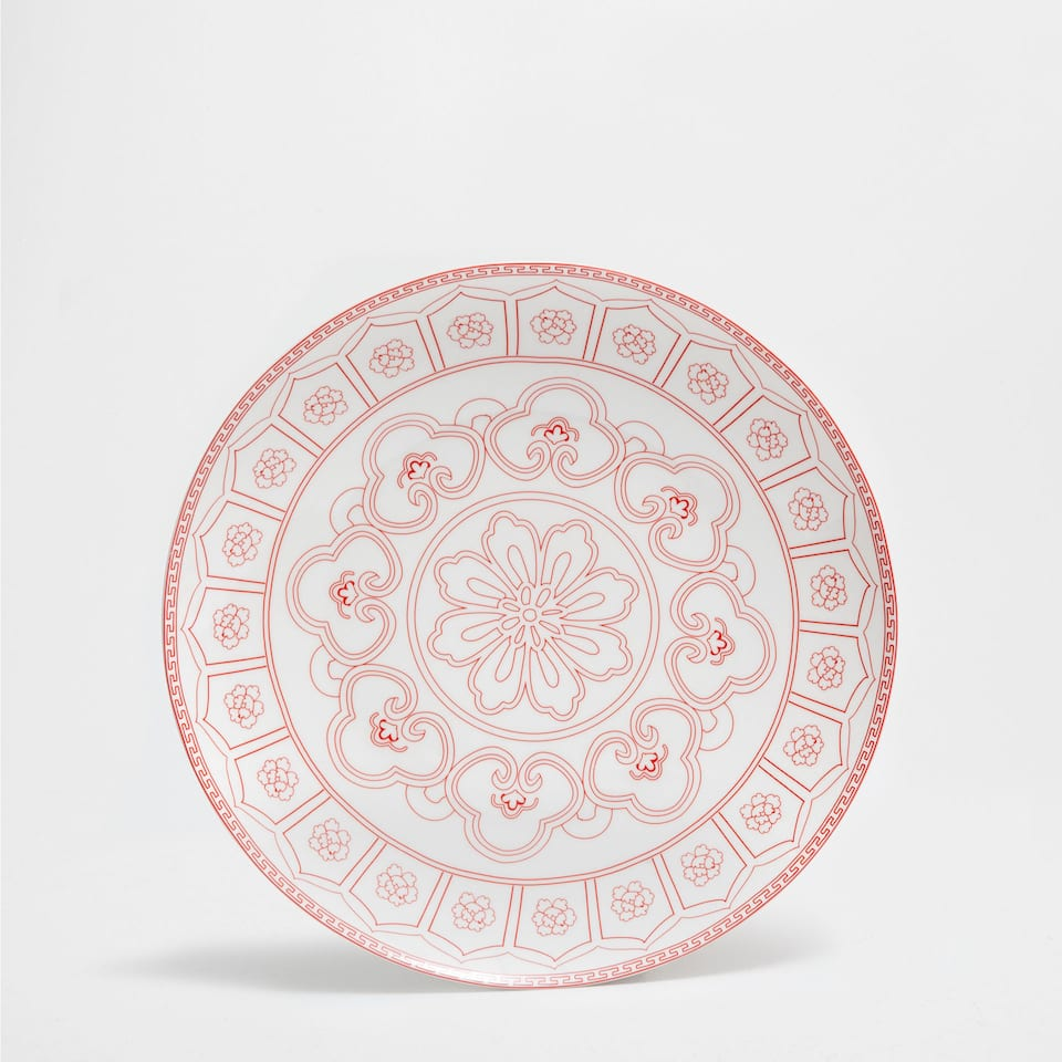 Oriental-design plate charger