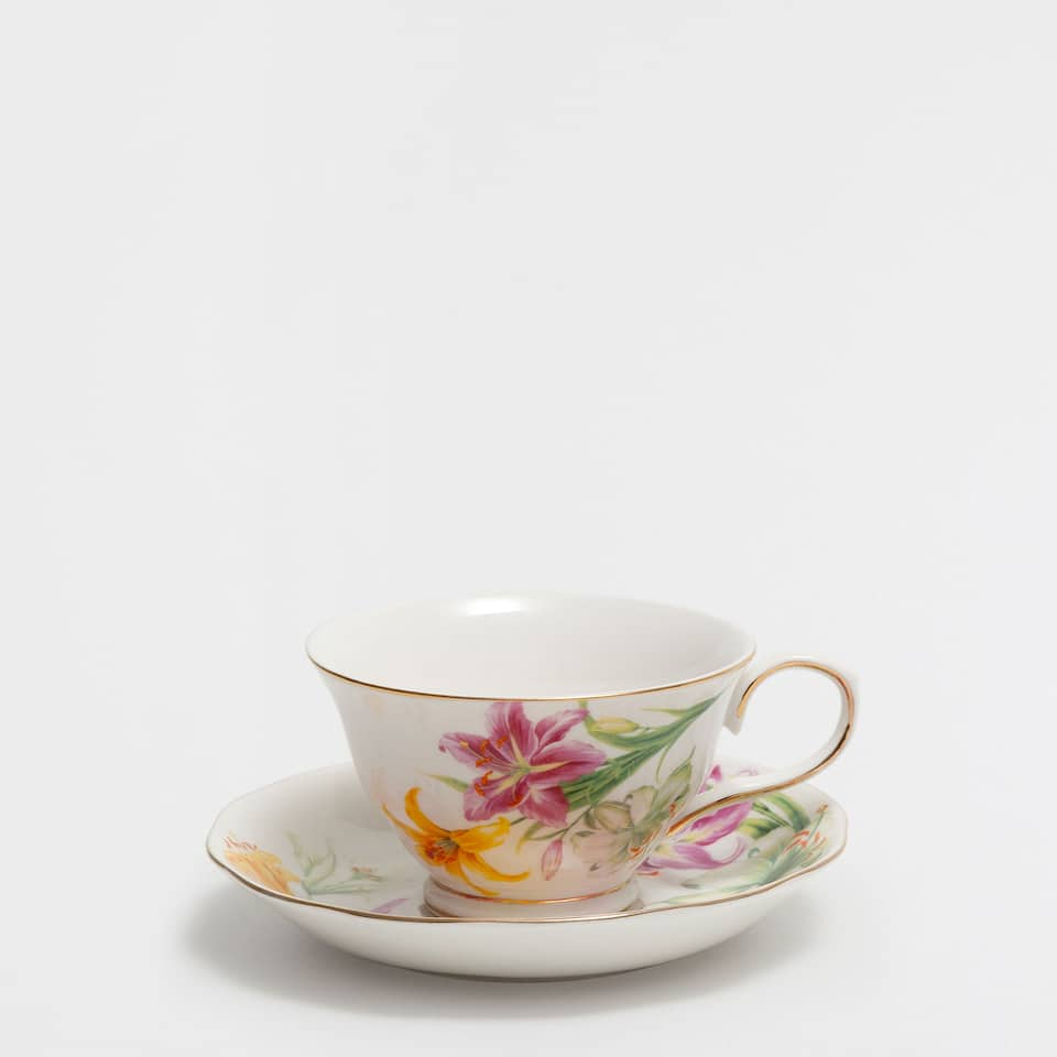 Golden-edge porcelain teacup and saucer