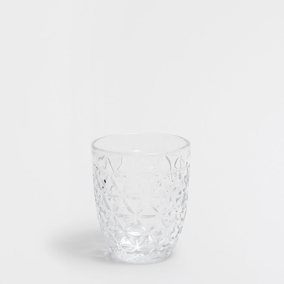 TUMBLER WITH A RAISED GEOMETRIC DESIGN