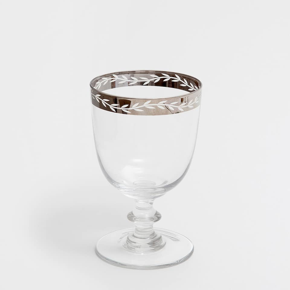 PATTERNED WINE GLASS WITH A SILVER RIM