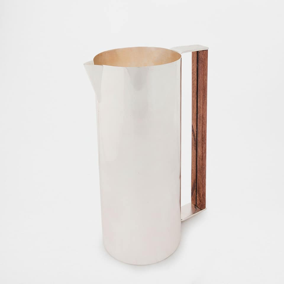 SILVER JUG WITH A WOODEN HANDLE