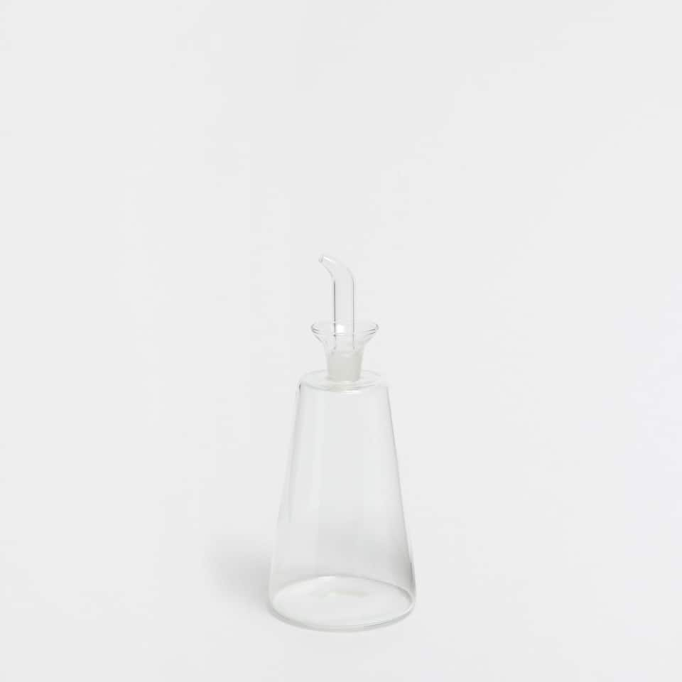 TRANSPARENT GLASS OIL BOTTLE