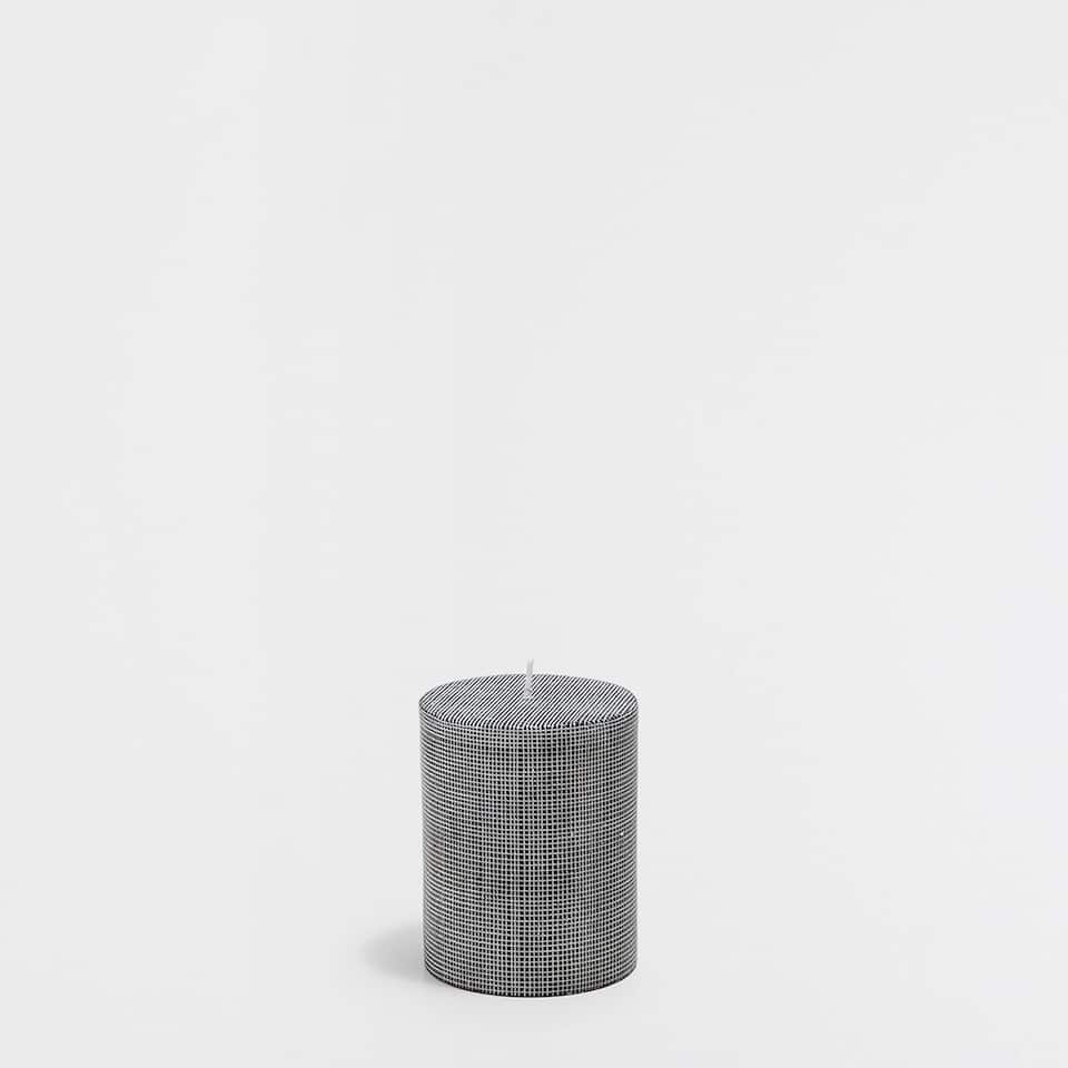 Engraved cylindrical candle