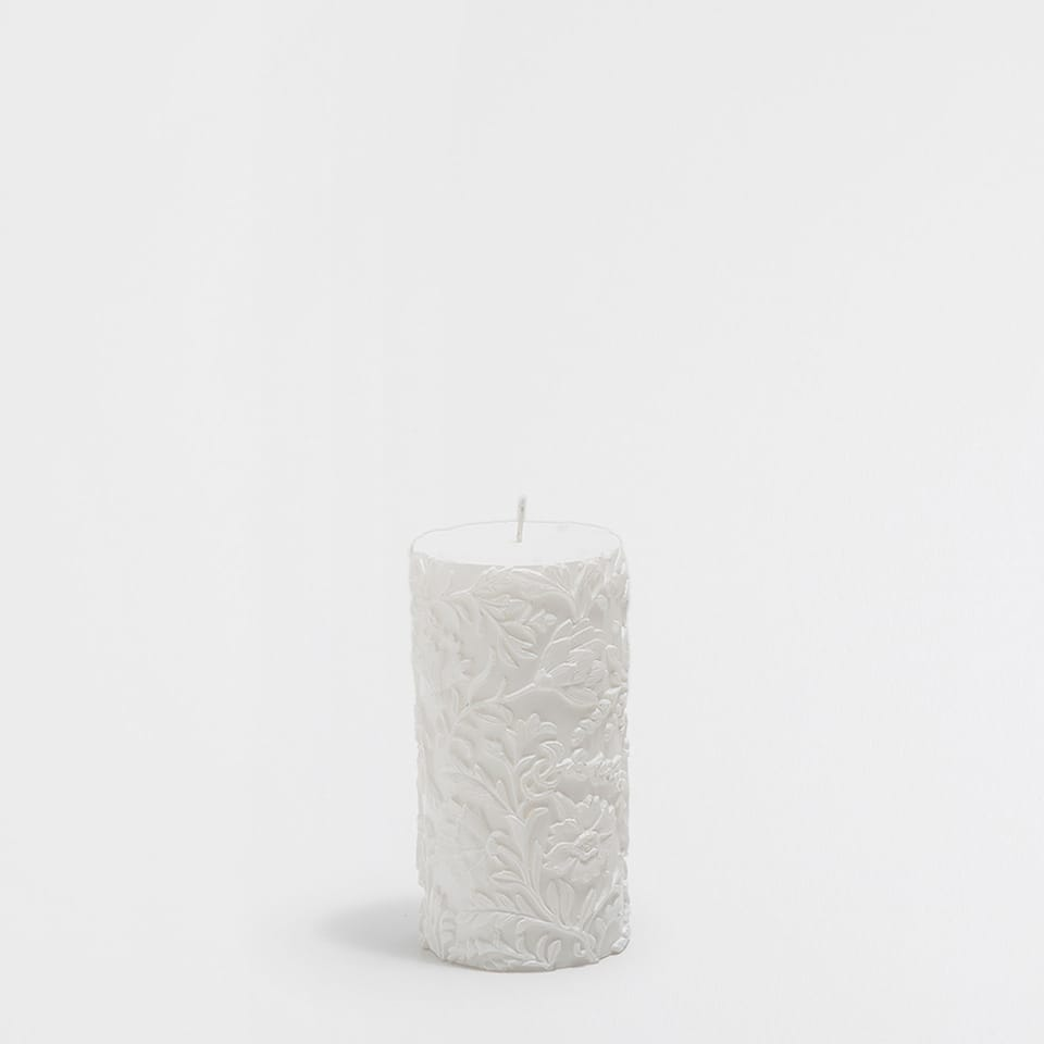 White raised cylindrical candle