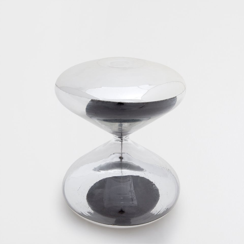 BLACK HOURGLASS WITH A SILVER DETAIL