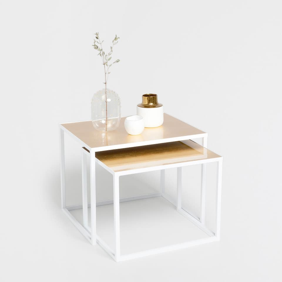 NEST OF WHITE AND GOLD TABLES
