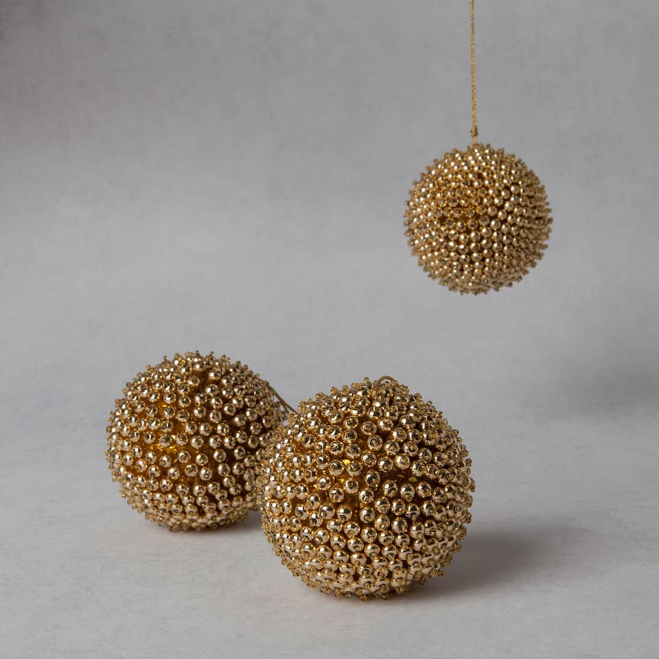 Golden studded bauble