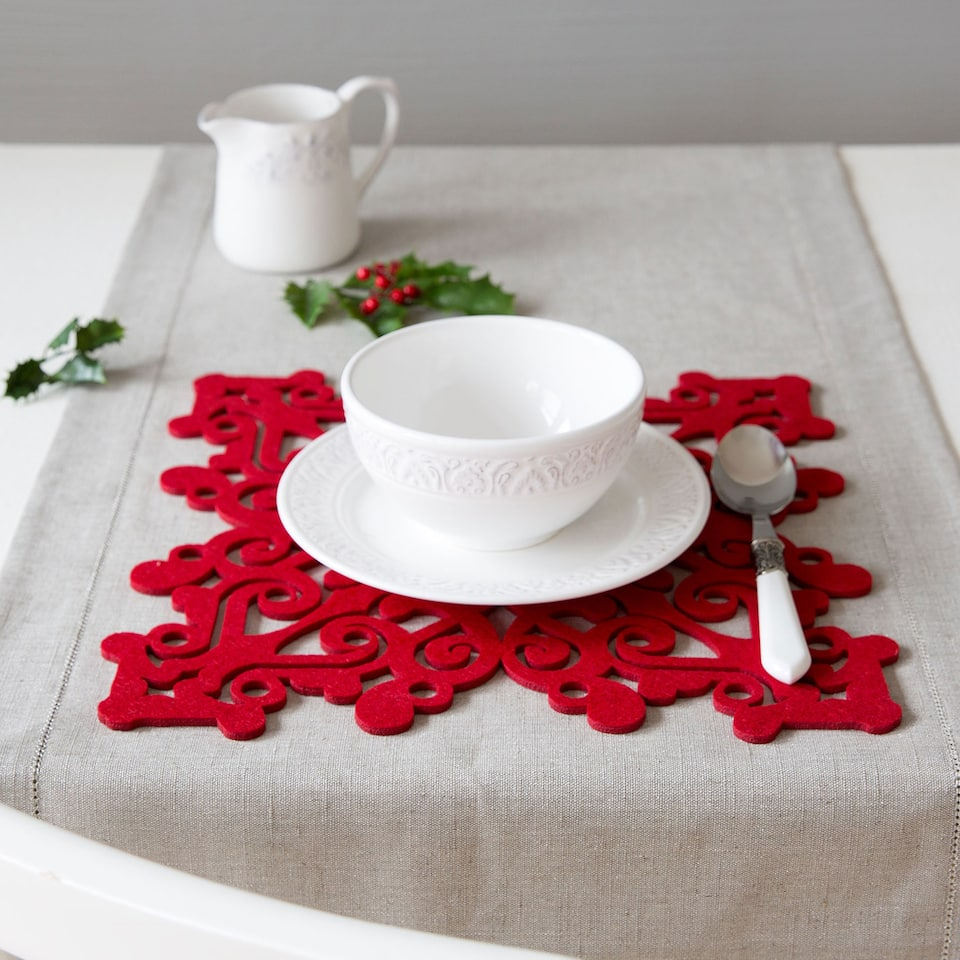 Square red felt cutwork placemat