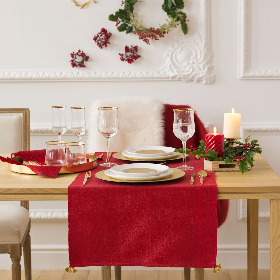 Red table runner with golden tassels