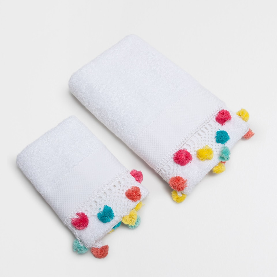 Embroidered cotton crochet towel with pompoms