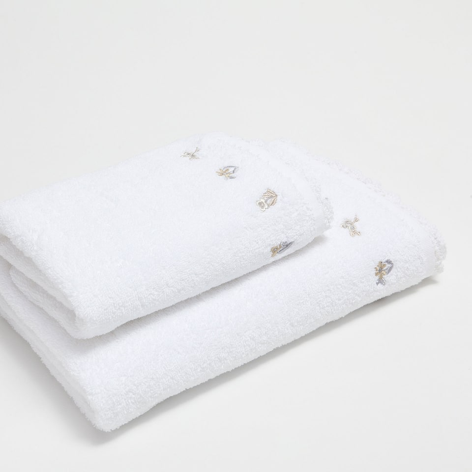 Embroidered floral cotton towel