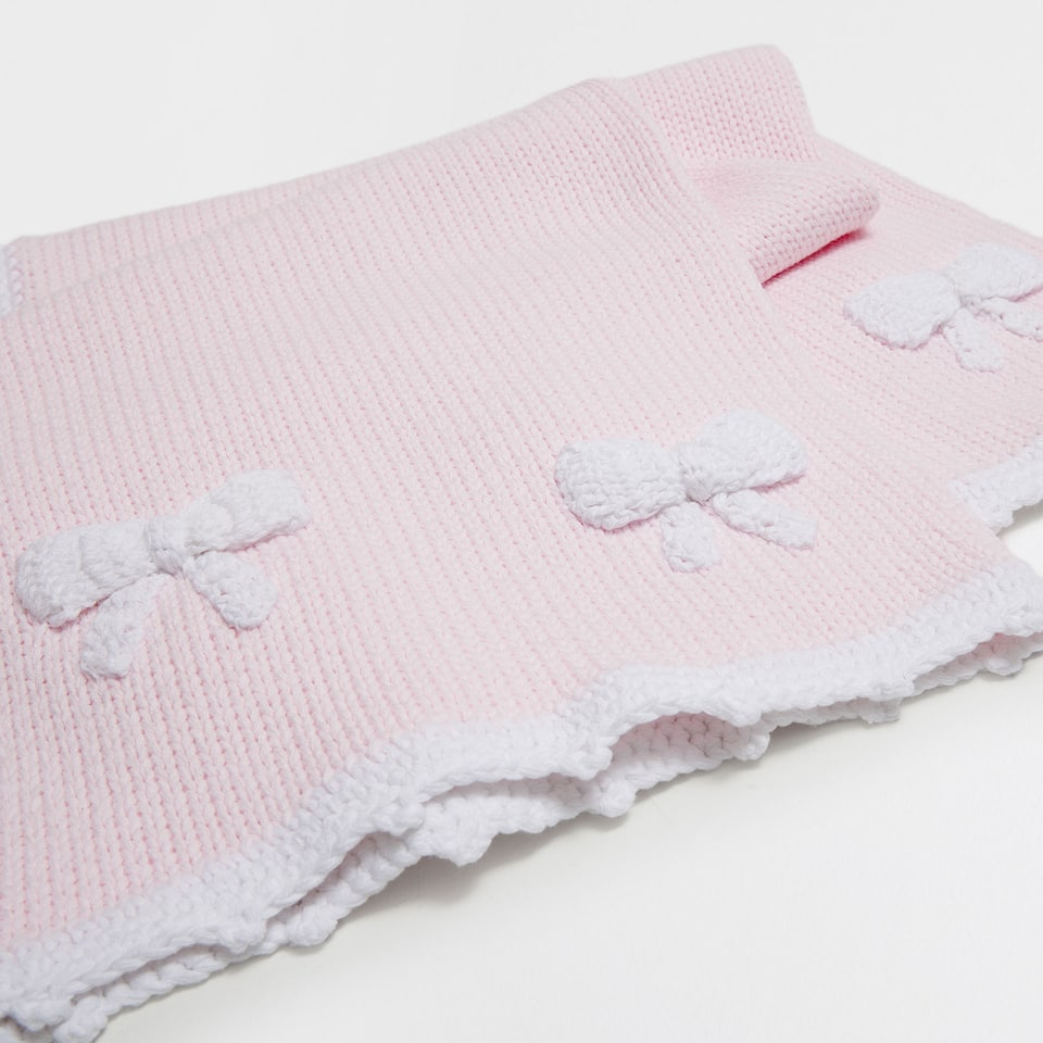 Cotton blanket with a bow appliqué