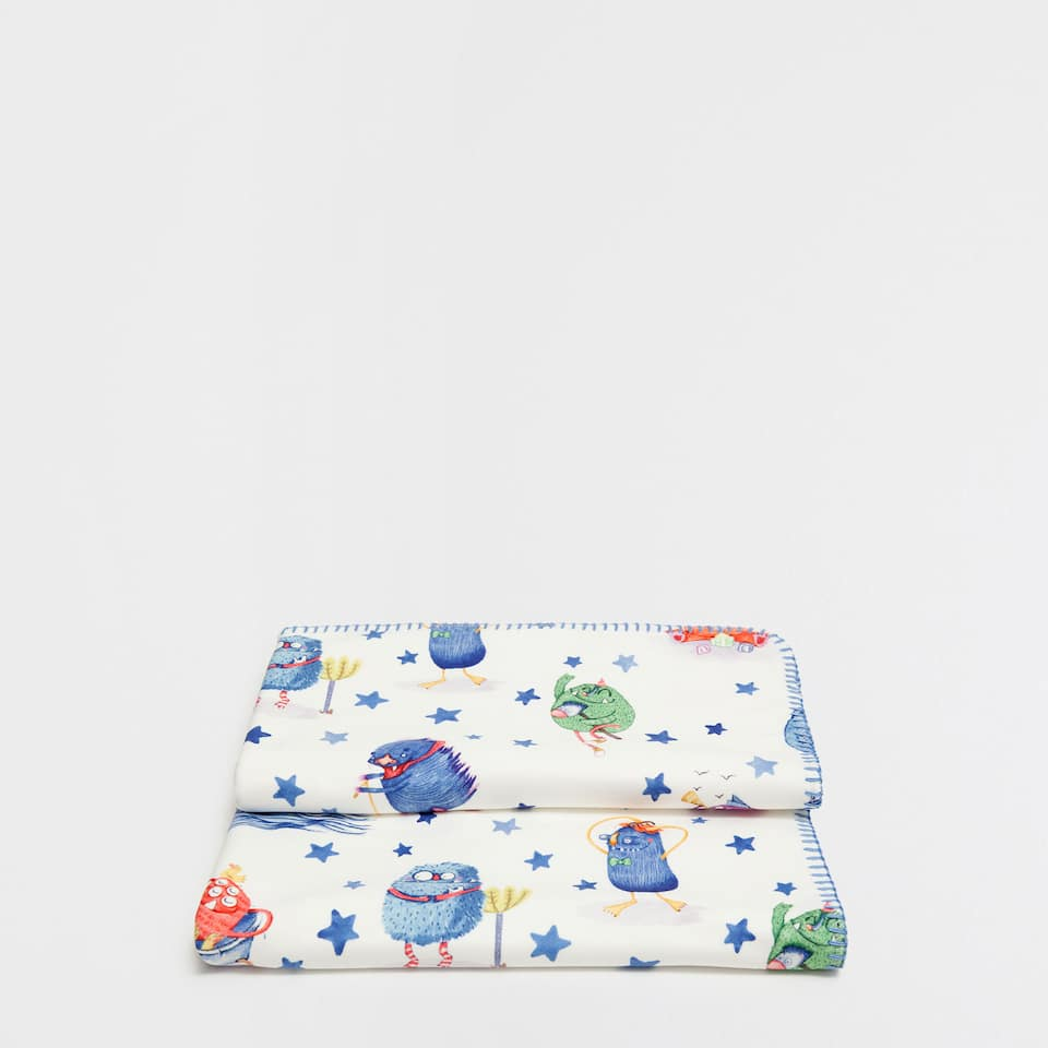 Stars and monsters printed blanket