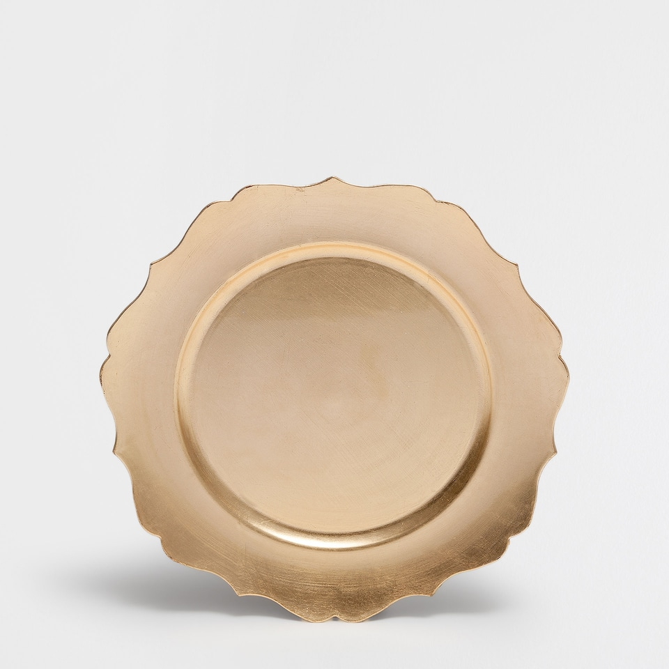 Golden plate charger with wavy edge