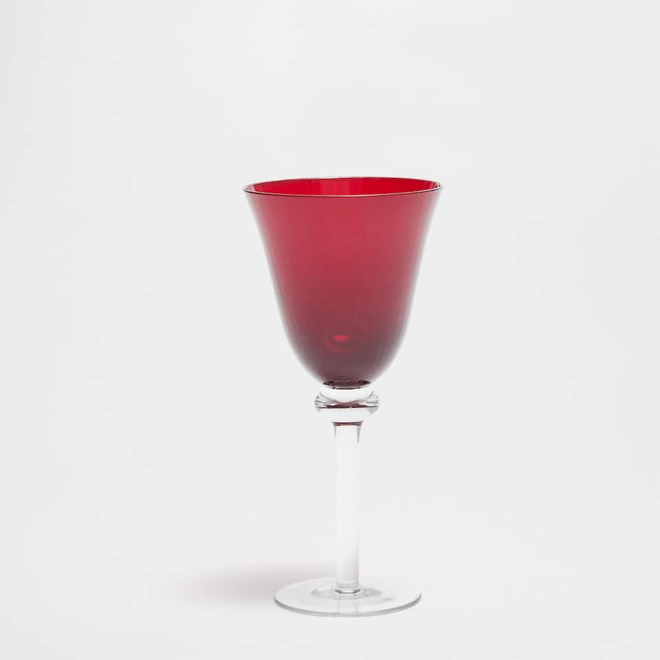 Red wine glass with transparent base