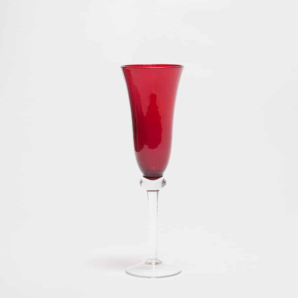 Red champagne flute with transparent base