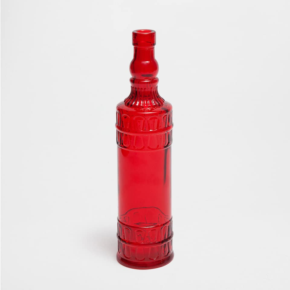 Red cut glass bottle