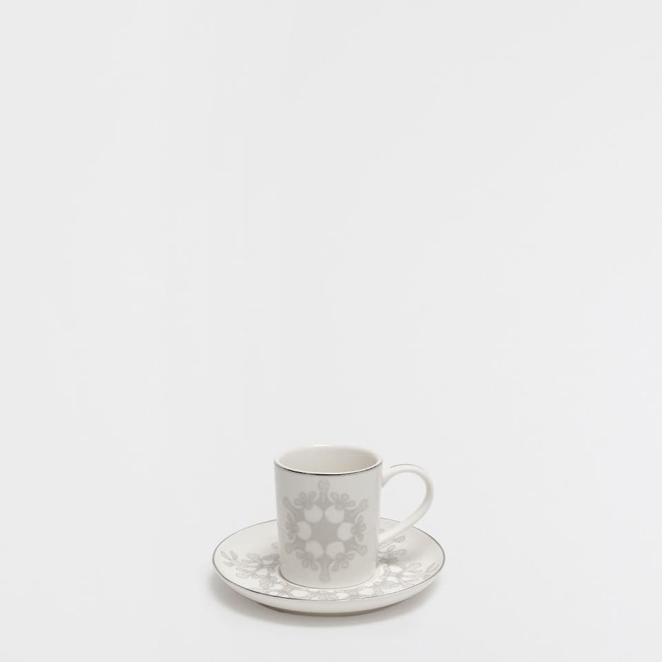 Porcelain printed coffee cup and saucer with silver rim