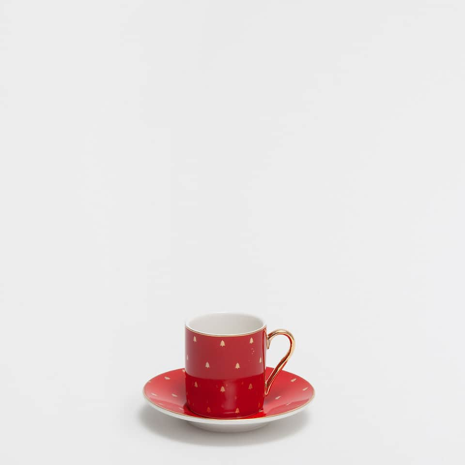 Red coffee cup and saucer with mini golden trees
