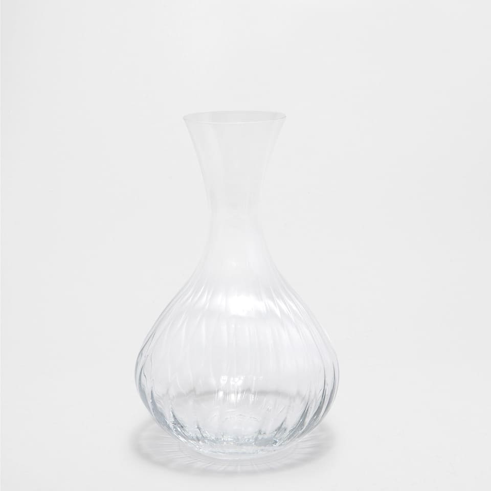 Thin decanter with a raised design