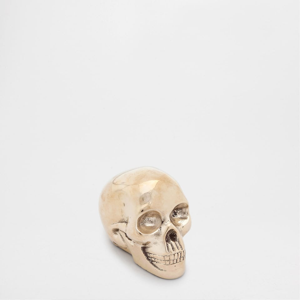 DECORATIVE SKULL FIGURE
