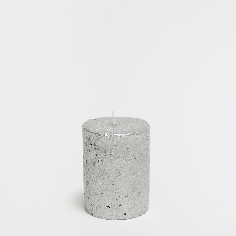 Silver cylindrical candle