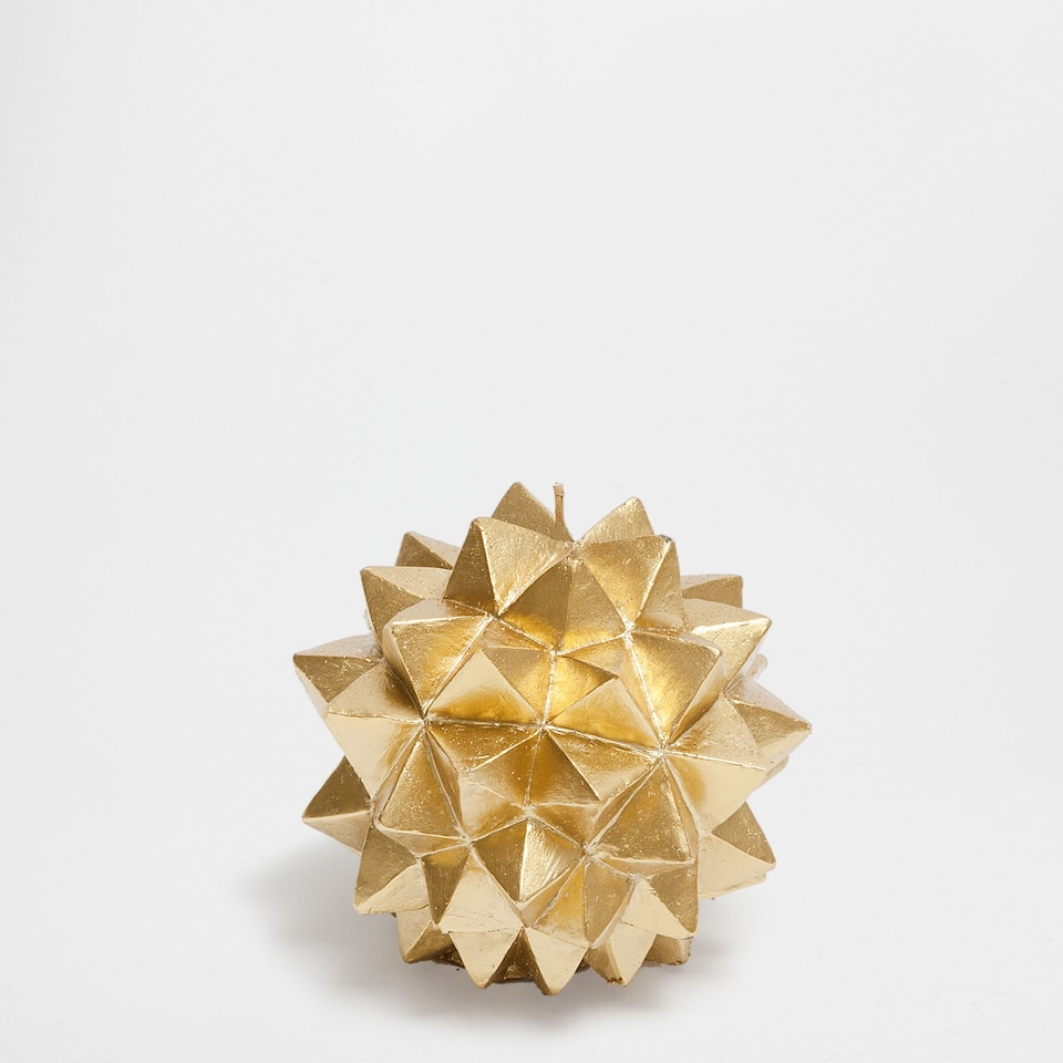 Golden geometric-shaped candle