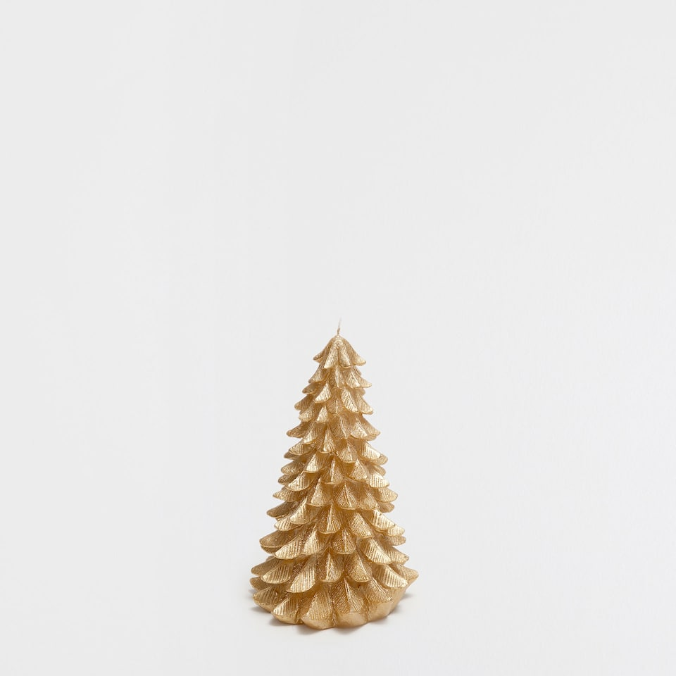 Small fir tree-shaped golden candle