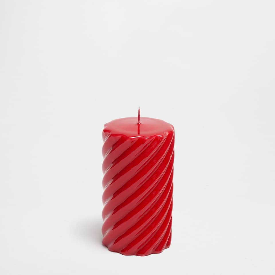 Red twisted cylindrical candle