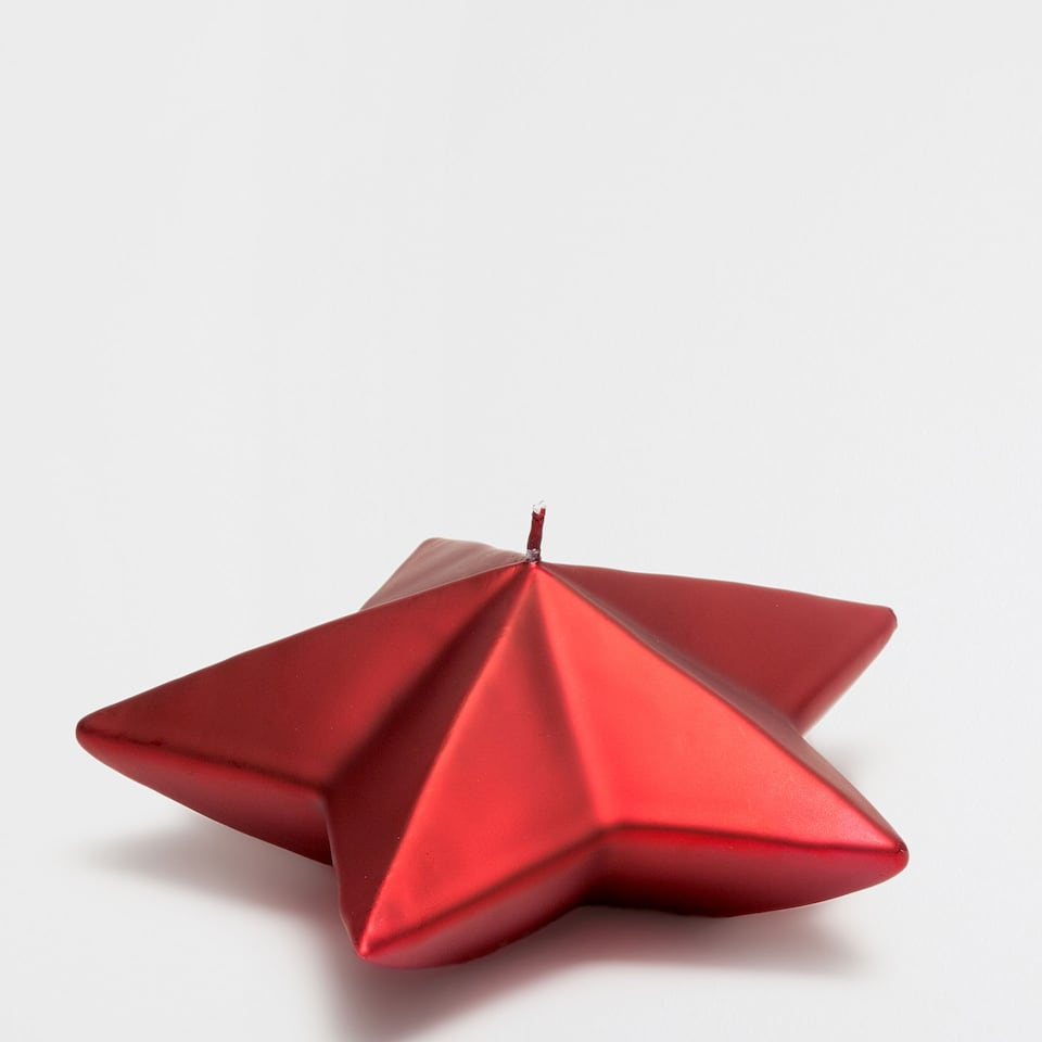 Large red star-shaped candle
