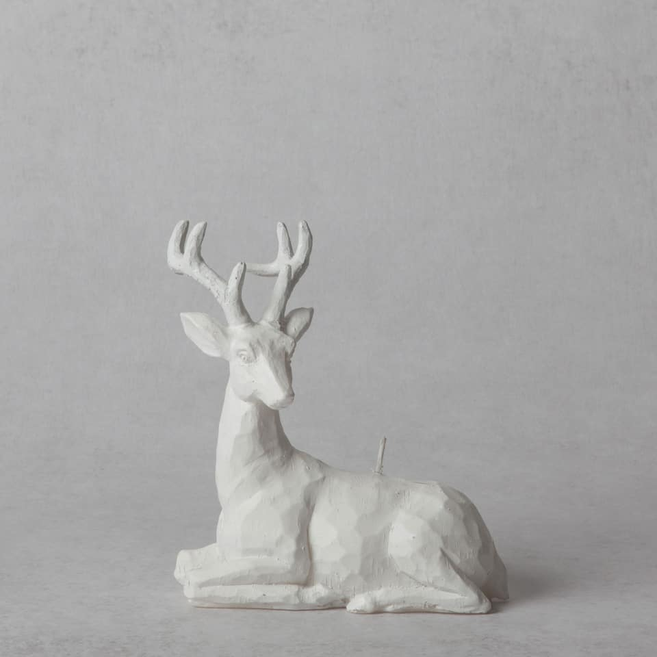 White reindeer-shaped candle