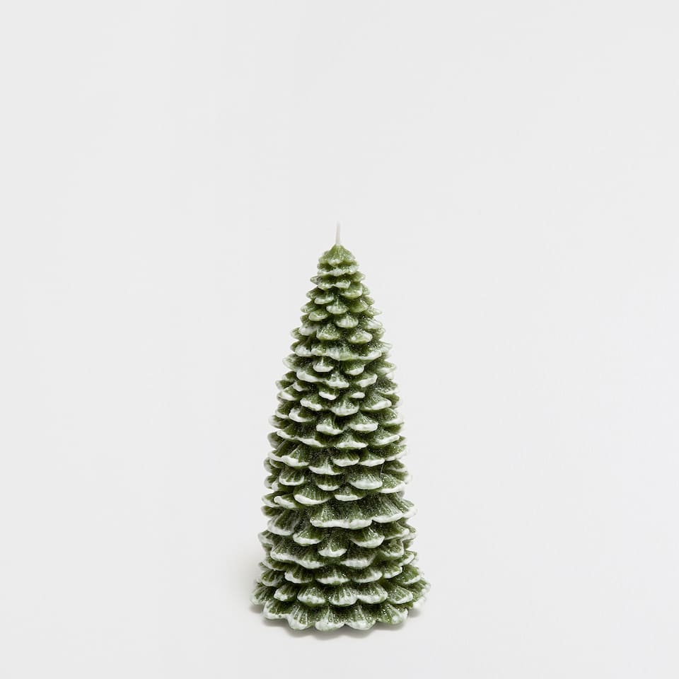 Green fir tree-shaped candle