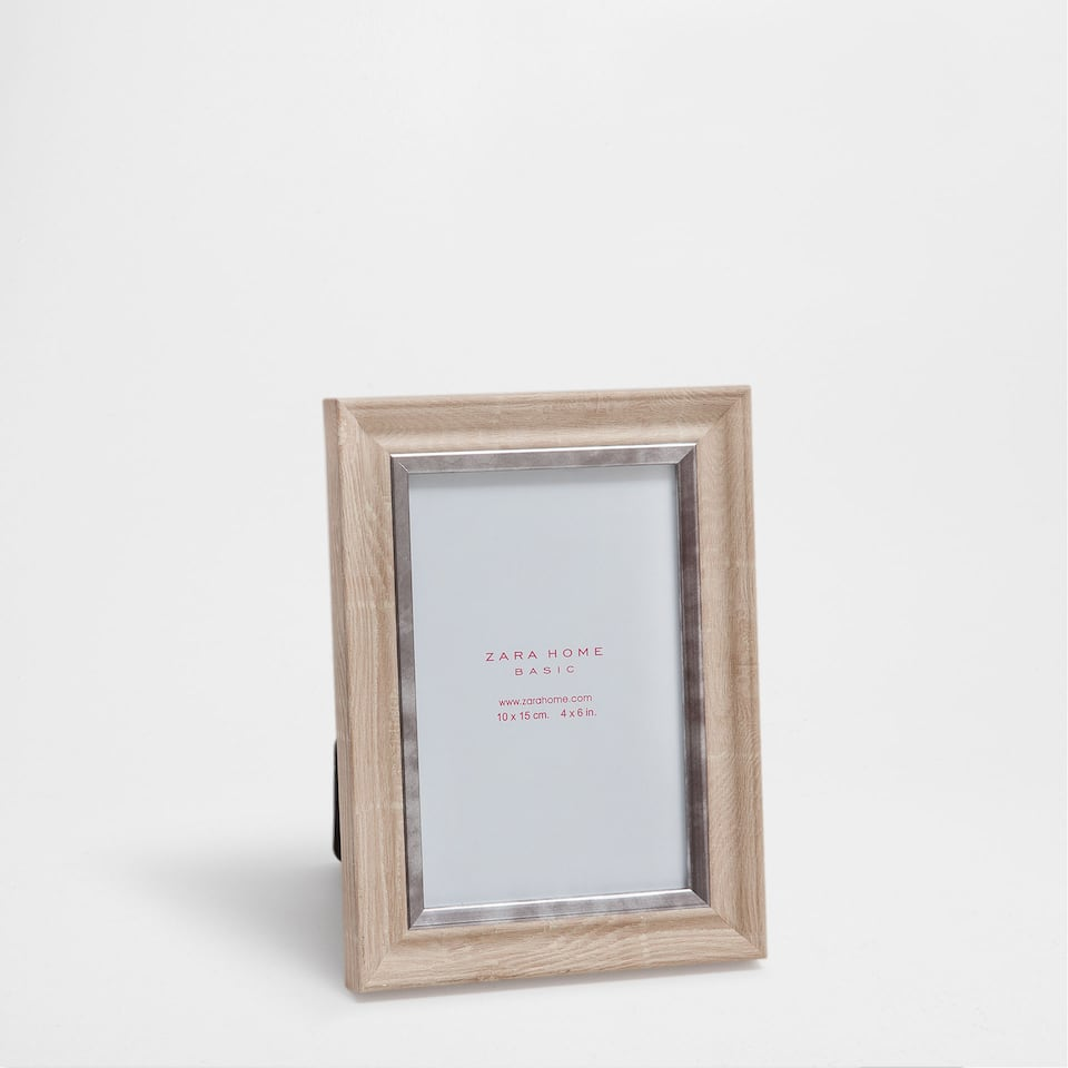 SAND-COLOURED FRAME WITH SILVER METAL CENTRE