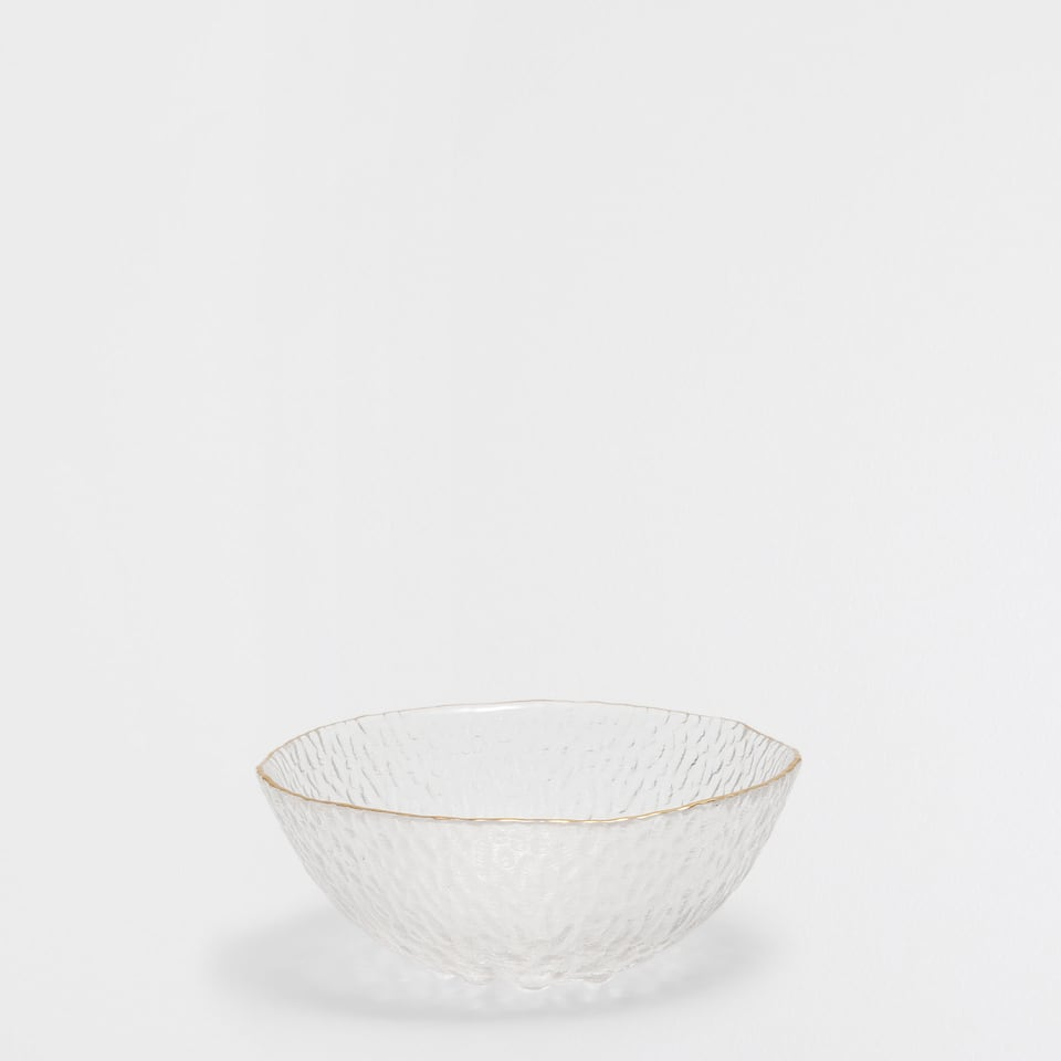 Metallic-rim glass bowl with a raised design