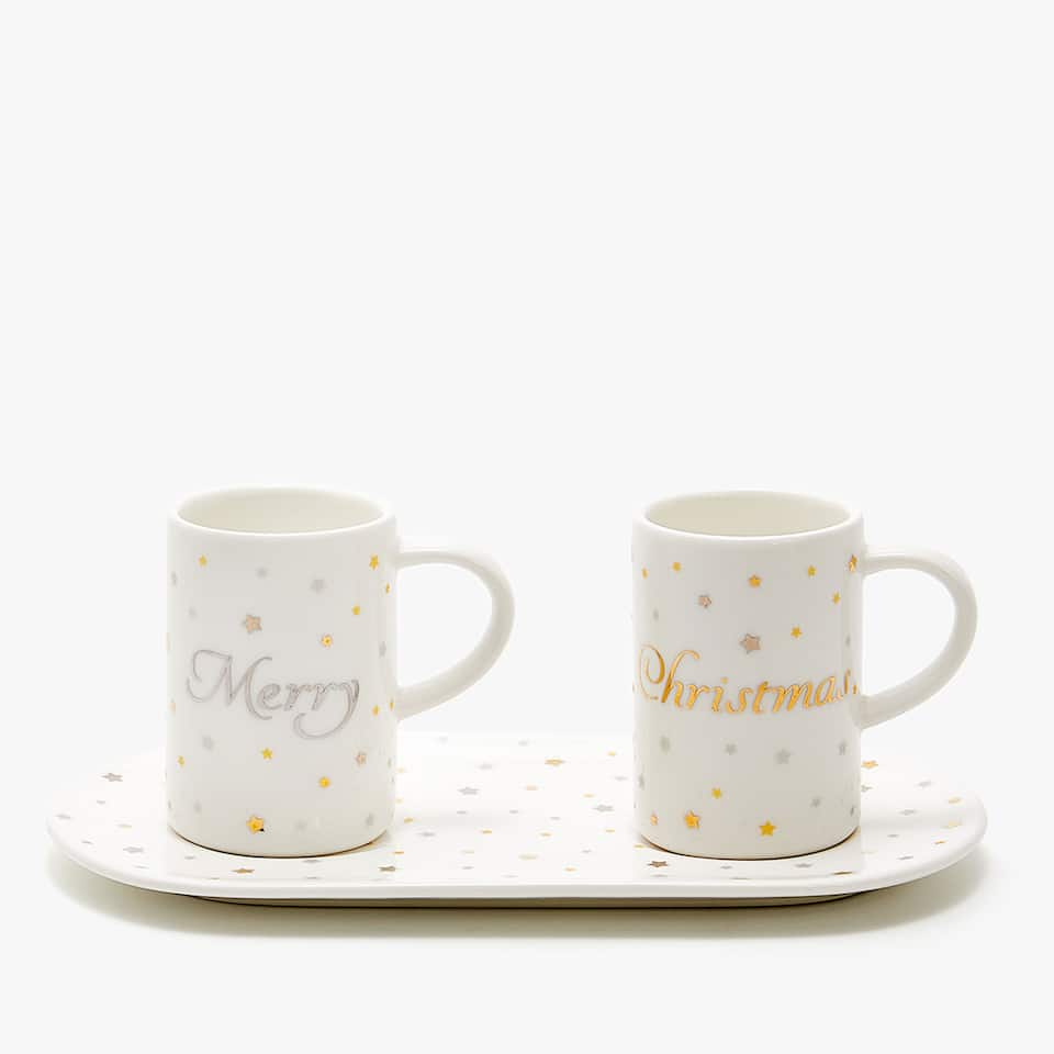 Set of two cups and saucer with star pattern