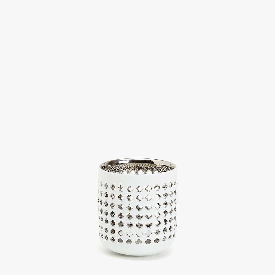 Tealight holder with perforated details