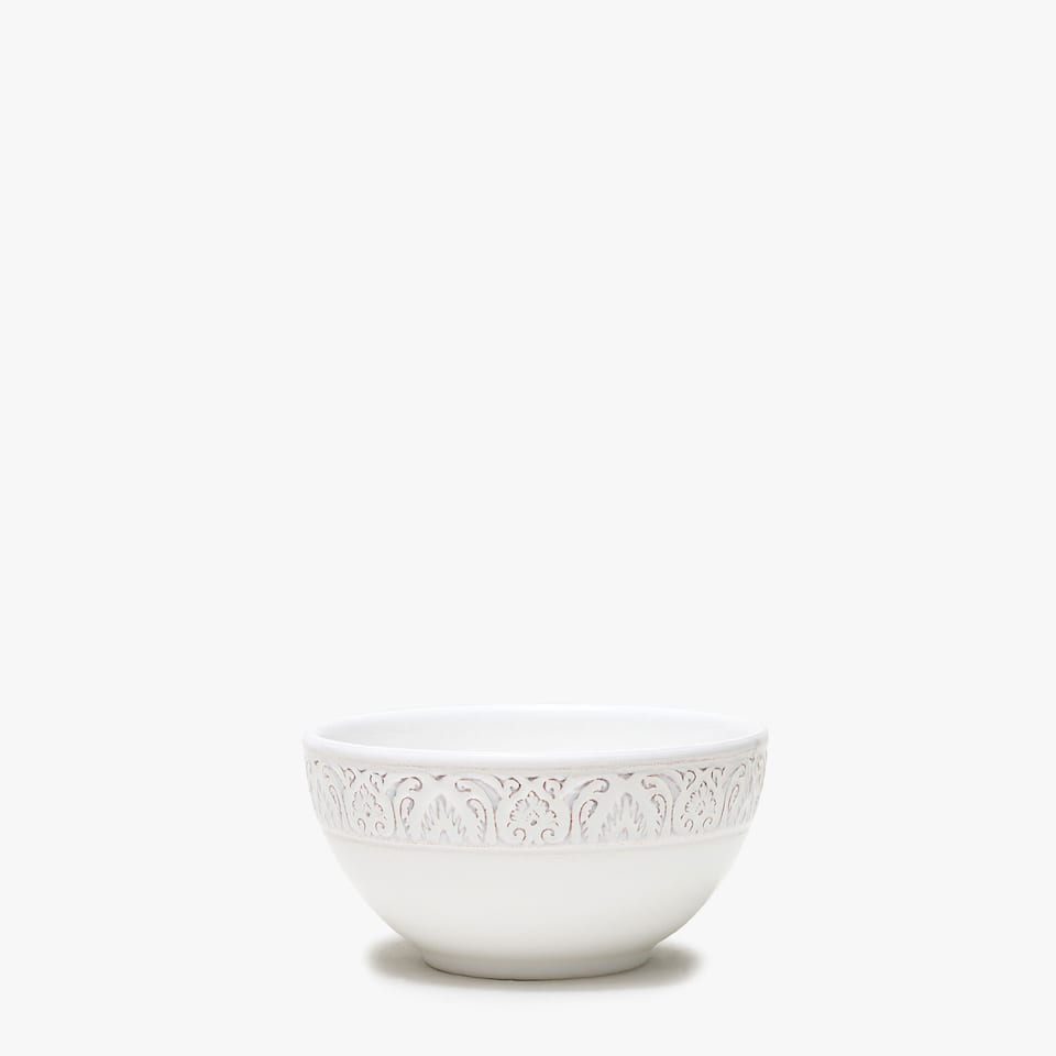 White raised-design earthenware bowl