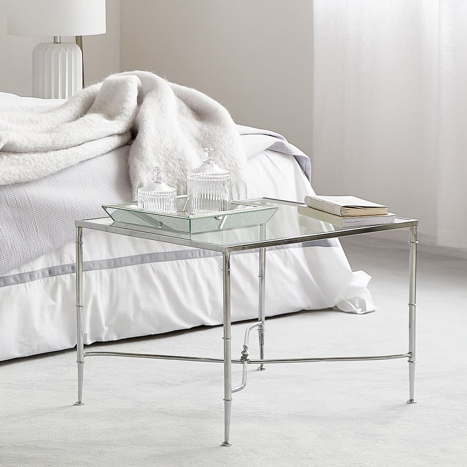 GLASS TABLE WITH CROSSED METAL BASE