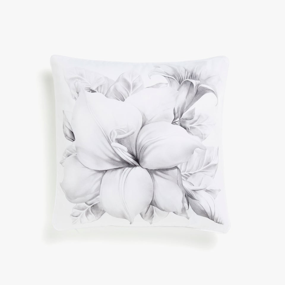 Cushion cover with large faded floral motif