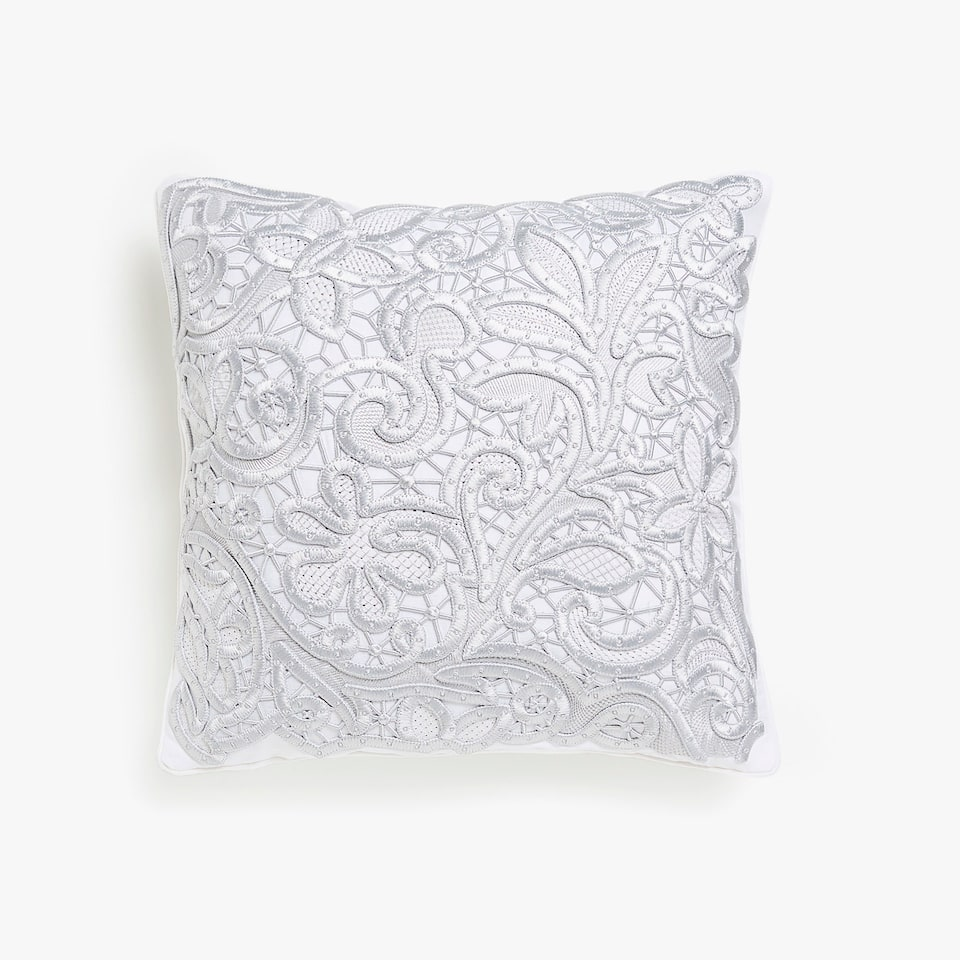 Textured silver embroidered cushion cover