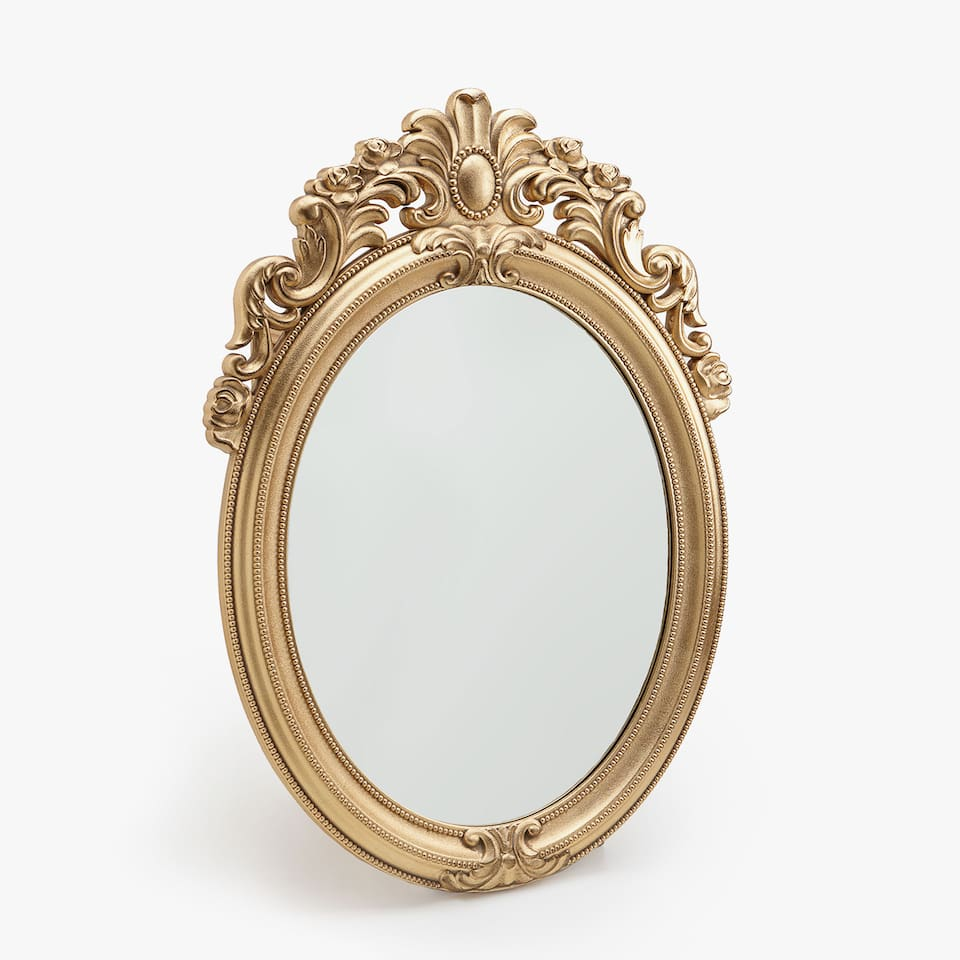 Oval mirror with detailed top