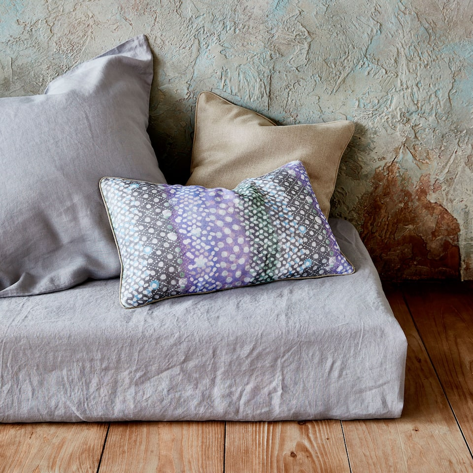 Multicoloured irregular-striped cushion cover