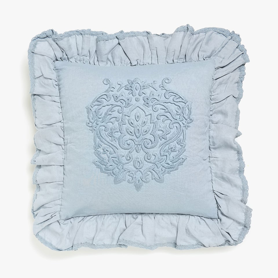 Frilled cushion cover with central embroidery