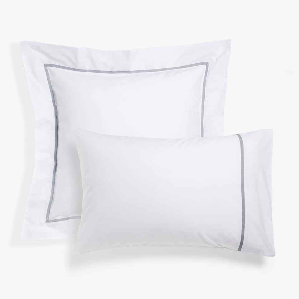 White pillow case with grey ribbon trim