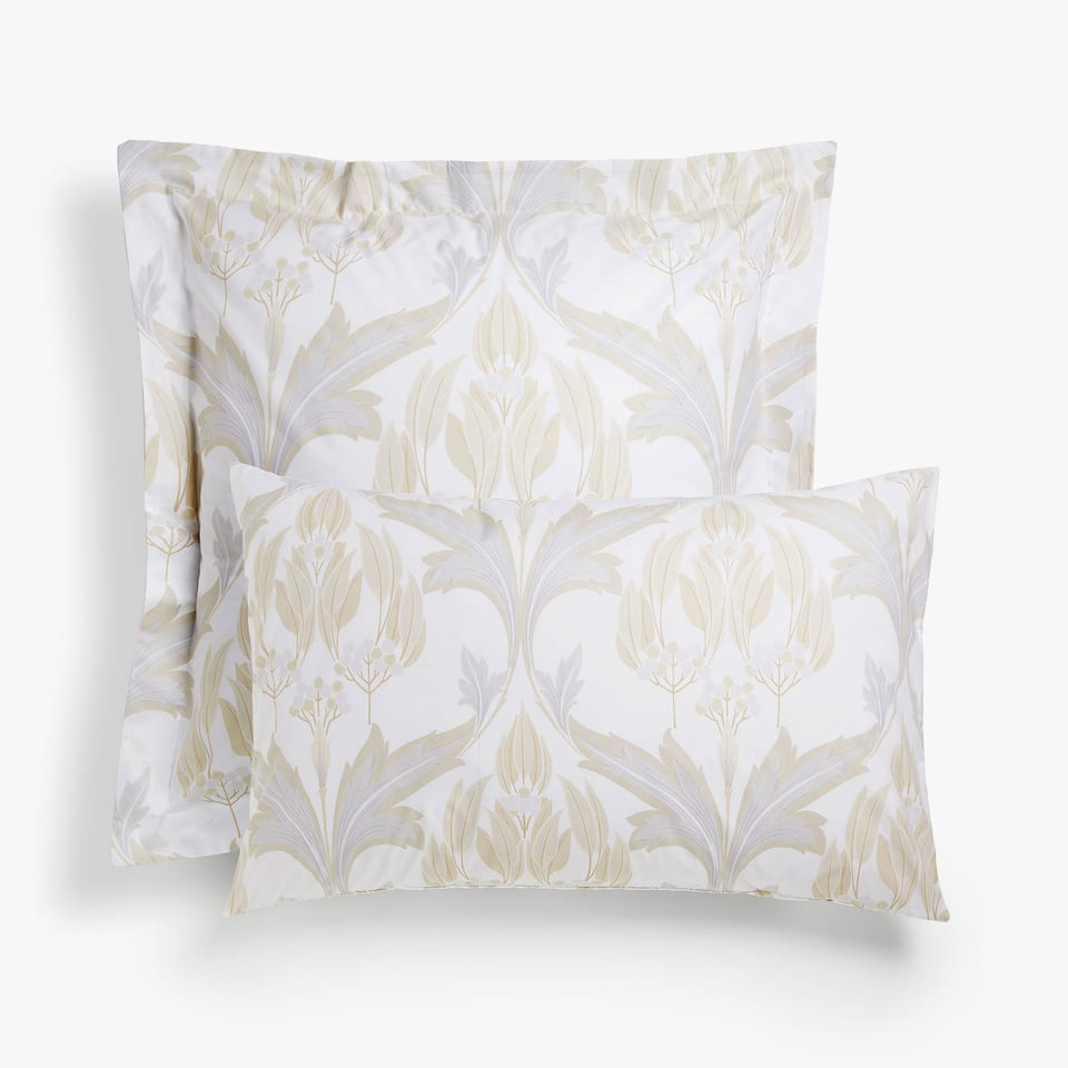 Gold and silver pillow case with ornamental print
