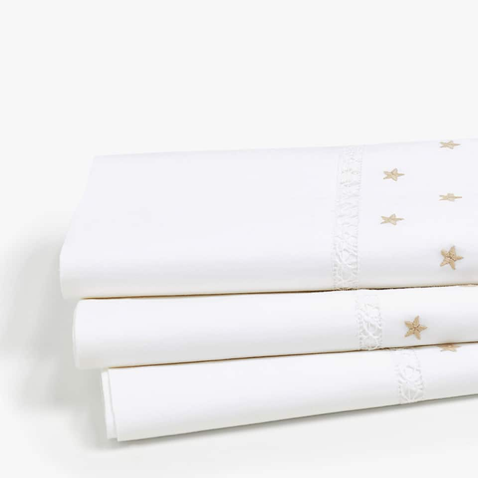 TOP SHEET WITH HEMSTITCHING AND EMBROIDERED STARS