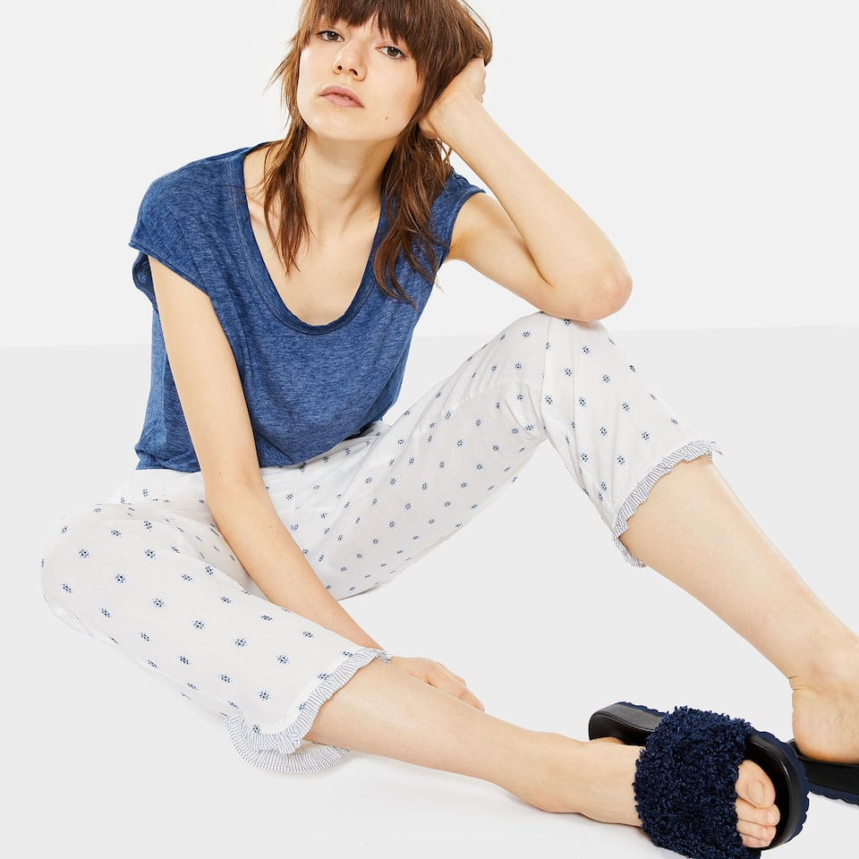 DOTTED MESH TROUSERS WITH CONTRASTING STRIPES